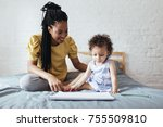 cute baby girl sitting on bed... | Shutterstock . vector #755509810