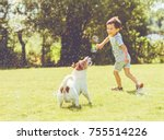 Stock photo carefree kid and pet dog playing with flying soap bubbles at sunny summer day 755514226