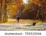 man running outdoors on cold... | Shutterstock . vector #755515246