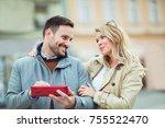 woman surprising her boyfriend... | Shutterstock . vector #755522470