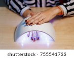 pretty girl dry your nails in... | Shutterstock . vector #755541733