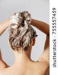 woman washing her blond hair | Shutterstock . vector #755557459