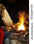 blacksmith tools in a hot oven... | Shutterstock . vector #755569759
