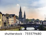 Small photo of View of Cork with bridge over Lee river and Saint Fin Barre's Cathedral in the far view at sunset, Ireland