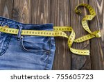 jeans  centimeter on a wooden... | Shutterstock . vector #755605723
