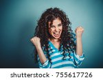 Stock photo lucky girl closeup portrait happy young brunette curly woman happy exults pumping fists ecstatic 755617726