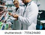 two chemist working in pharmacy ... | Shutterstock . vector #755624680