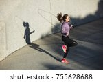 fitness woman skipping with a... | Shutterstock . vector #755628688