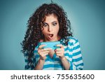 shocked look at phone. closeup... | Shutterstock . vector #755635600