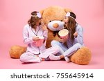 two happy pretty girls dressed... | Shutterstock . vector #755645914