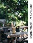 iced coffee on the table nature ... | Shutterstock . vector #755648680