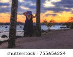 girl watching sunset in a... | Shutterstock . vector #755656234