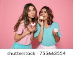 two charming girls in colorful... | Shutterstock . vector #755663554