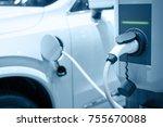 charging an electric car... | Shutterstock . vector #755670088