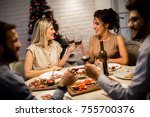 friends celebrating christmas... | Shutterstock . vector #755700376