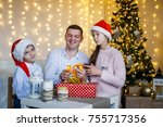 a family of three wrapping... | Shutterstock . vector #755717356