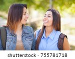 two beautiful young ethnic twin ... | Shutterstock . vector #755781718