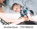 pregnant mother and son are... | Shutterstock . vector #755788633