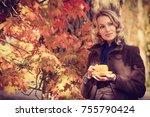 adult woman is holding hot cap... | Shutterstock . vector #755790424
