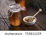 honey in jar with honey dipper... | Shutterstock . vector #755811229