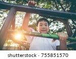 Asian Child Climbing And Havin...