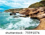 Wave Breaking On The Rocky Shore