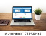 laptop computer on wood table...   Shutterstock . vector #755920468