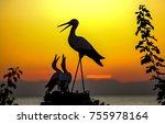stork nest sunset silhouettes | Shutterstock . vector #755978164