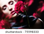 attractive woman with rose - stock photo