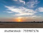 Desert Sunset With Blue Sky An...