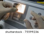 dentist checking an x ray of...   Shutterstock . vector #75599236