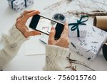 girl making photo of gift boxes ... | Shutterstock . vector #756015760