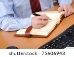 a young business man working in ... | Shutterstock . vector #75606943