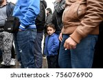 Small photo of Thessaloniki, Greece - November 15, 2017. A refugee boy from Syria looks at the camera, as refugees protest in Aristotelous Square, demanding for the borders of European Union to open for them.