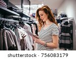 young woman in a store holding... | Shutterstock . vector #756083179