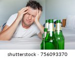 Hangover Suffering Man Holding...