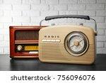 retro radios on table near... | Shutterstock . vector #756096076