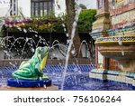 Green Frog Statue Pours Water...