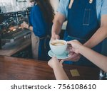 close up hand holding a coffee... | Shutterstock . vector #756108610