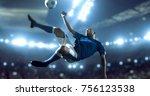 soccer player kicks the ball on ... | Shutterstock . vector #756123538