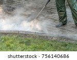 worker cleaning driveway with... | Shutterstock . vector #756140686