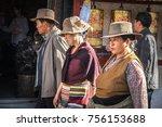 Small photo of Lhasa, Tibet, China - July 2017. Tibetan pilgrims walking on the Barkhor street in Lhasa