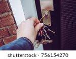 hand opening house door with...   Shutterstock . vector #756154270
