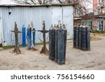 rows of old dirty gas cylinders