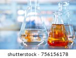 glass flask with orange... | Shutterstock . vector #756156178