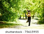 a young girl jogging in the... | Shutterstock . vector #75615955