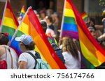 people with rainbows flags in... | Shutterstock . vector #756174766