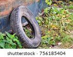 used car tire left in nature.... | Shutterstock . vector #756185404