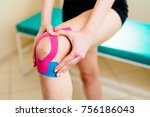 woman massage injured knee with ... | Shutterstock . vector #756186043