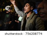 Small photo of Thessaloniki, Greece - November 15, 2017. A young refugee man reacts in front of a Greek police blockade, as refugees try to march from Thessaloniki to the Greek - Macedonian border.